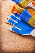 Paint tray brushes duct tape and protective gloves — Stock Photo