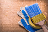 Protective gloves paint brush and duct tape — Stock Photo