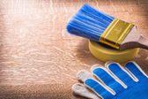 Safety gloves duct tape with paintbrush — Stock Photo