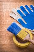 Safety gloves with paint brush — Stock Photo