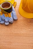 Safety building helmet and protective gloves — Stock Photo