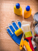 Toolkit with paint cans and bottles — Stock Photo