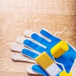 Working gloves, brush and roller — Stock Photo #73074533
