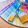 Paint brushes  on color palette — Stock Photo #73074643