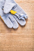 Adjustable spanner on  protective glove — Stock Photo