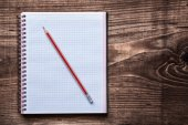 Squared copybook with pencil — Stock Photo