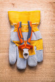 Nippers on  protective glove — Stock Photo