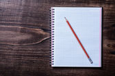 Pencil and clean squared copybook — Stock Photo