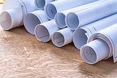 Set of blueprint rolls on wooden  board — Stock Photo