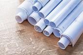 Stack of blueprint rolls on wood — Stock Photo