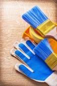 Working gloves, paint brushes — Stock Photo