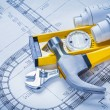 Construction level, claw hammer, blueprints — Stock Photo #73634033