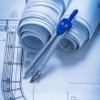 Rolls of blueprints and drawing compass — Stock Photo #73634719