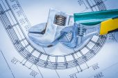 Adjustable spanners on construction blueprint — Stock Photo