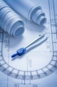 Blueprint rolls and pair of compasses — Stock Photo