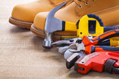 Boots, hammer, tapeline, nippers, cutter — Stockfoto