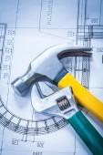 Claw hammer, adjustable key on plan — Stock Photo