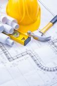 Hammer, blueprints, construction level, helmet — Stock Photo