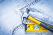 Claw hammer, blueprints, construction level — Stock Photo