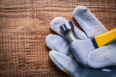 Claw hammer on protective glove — Stock Photo