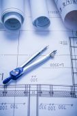 Compass and rolled blueprints — Stock Photo