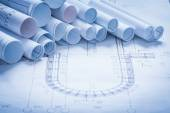 Heap of rolled up construction drawings — Stock Photo