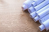 Heap of blueprint rolls — Stock Photo