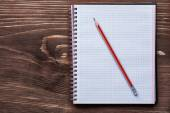 Pencil and squared notepad — Stock Photo