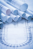 Pile of rolled up construction plans — Stock Photo