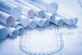 Variety of rolled up construction plans — Stock Photo