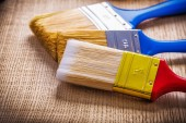 Paint brushes on wooden board — Stock Photo