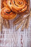Wicker basket with raisin bakery goods — Stock Photo