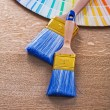 Two paint brushes and color palette — Stock Photo #74284169