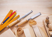 Carpentry set joiners chisels wooden meter pencil shavings and b — Stock Photo