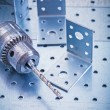 Drilled angle fasteners and metal drill — Stock Photo #74905611