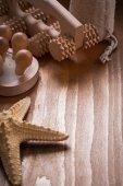 Massagers on pine vintage wood background — Stock Photo