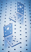 Stainless perforated angle fasteners — Stockfoto