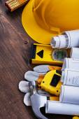 Construction plans and group of building tools — Stock Photo