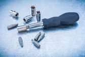 Screwdriver and group of steel screw bits — Photo
