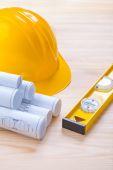 Construction level, hardhat and blueprints. — Stock Photo
