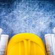 Architectural construction plans with building helmet — Stock Photo #76430007