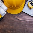 Checked notepad, pencil and construction objects — Stock Photo #76430041