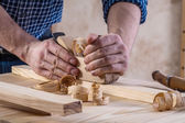 Joiners hands with woodworkers plane — Stock Photo