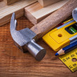 Ruler, pencil, blueprints, claw hammer — Stock Photo #77375044