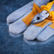 Protective gloves with pliers — Stock Photo #77377538
