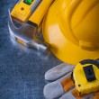 Gloves, hard hat and claw hammer — Stock Photo #77377720