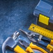 Toolbox, hammer, ruler, pliers — Stock Photo #77379282