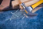 Nails, hammer, wooden bricks, hacksaw — Stock Photo