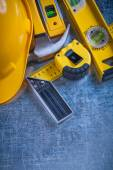Construction level, protective helmet and hammer — Stock Photo