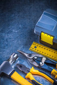Toolbox, claw hammer, ruler, pliers — Stock Photo